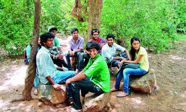 Students enjoy the shade under the trees while sitting on the philosopher 'thrones' at MCC in Tambaram on Saturday.— DC