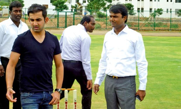 Gautam Gambhir takes a walk down the pitch of the cricket ground that he inaugurated in Theni, Dindigul in Tamil Nadu. (DC Photograph)