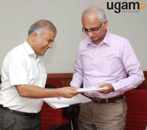(Left to right)Dr Rudramoorthy Principal, PSG Polytechnic college and Mr Sunil Mirani, CEO Ugam Solutions exchanging the MOU