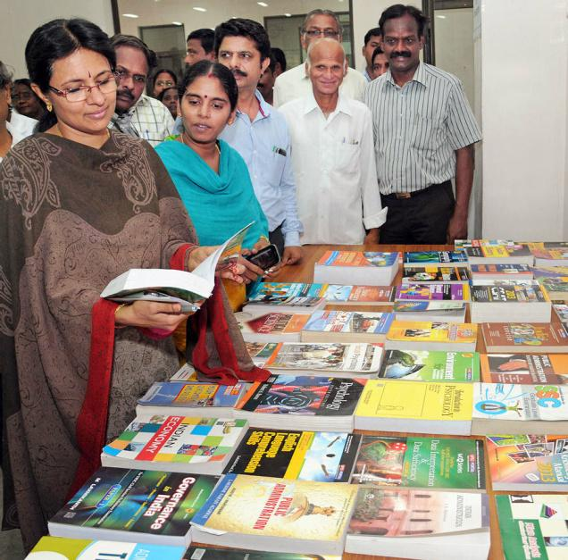 Collector Jayashree Muralidharan going through the books at Central Library in Tiruchi on Thursday. — PHOTO: M. MOORTHY / The Hindu