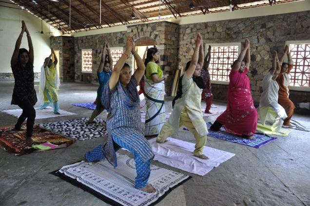 INVIGORATING EXERCISE: Yoga session under way at Gandhi Memorial Museum./ Photos: G. Moorthy / The Hindu