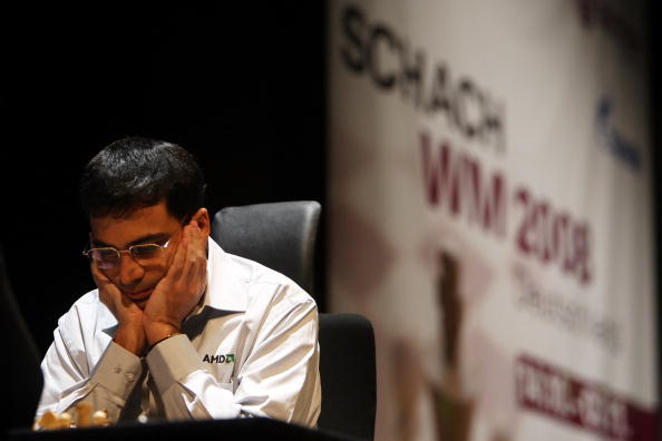 BONN, GERMANY - OCTOBER 17:  Indian chess world champion Viswanathan Anand concentrates during his match against the Russian chess grandmaster Vladimir Kramnik  on October 17, 2008 in Bonn, Germany.  (Photo by Patrik Stollarz/Getty Images)
