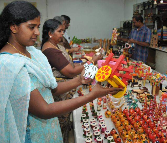 Some of the toys at the wooden dolls exhibition at Poompuhar showroom have been sourced from Ambasamudram, Channapatna, and Kondapalli ./. Photo: M. Moorthy / The Hindu