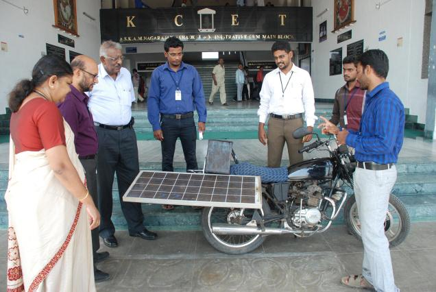 Students explaining the newly developed solar hybrid bike to their faculty members. / The Hindu