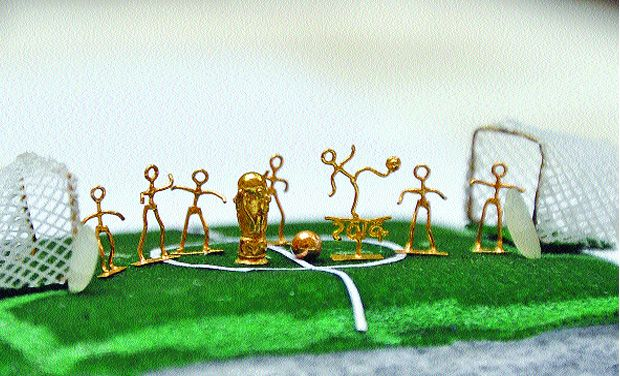 A miniature model of World Cup and a lively football match made out of gold (Photo: DC)