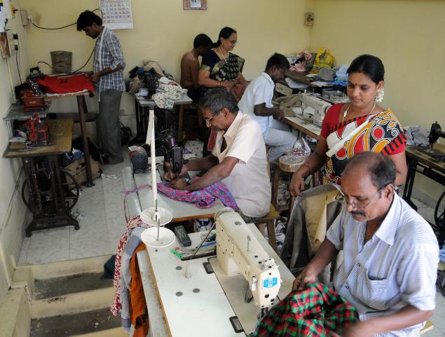 Giving clothes a second innings: Employees of Re-Stitch Point./ Photo: K. Pichumani / The Hindu