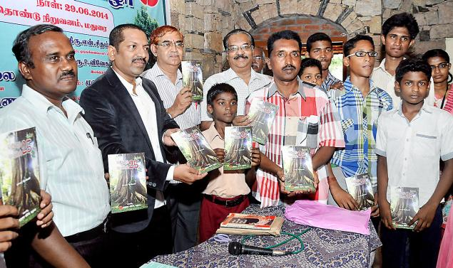Madurai Trees 25' being released in Madurai on Sunday. Author D. Stephen, left, Assistant Professor in Botany, The American College, is seen. / Photo: R. Ashok / The Hindu