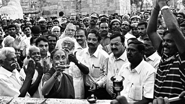 Santha Sheela Nair, retired IAS officer and vice president of Tamil Nadu Planning Commission, lighting the first lamp at the Chozeeshwarar temple in Gangaikonda Cholapuram on Friday | express