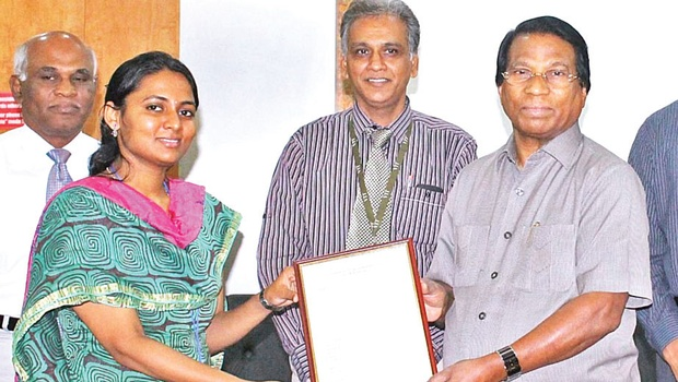 A copy of the patent being handed over to Srilavanya by VIT Chancellor G Viswanathan on Wednesday   EXPRESS