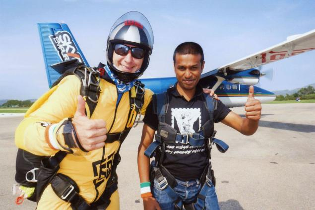 P.S.Karthikeyan seen with his tandem instructor at the record-setting event held in Spain. / The Hindu