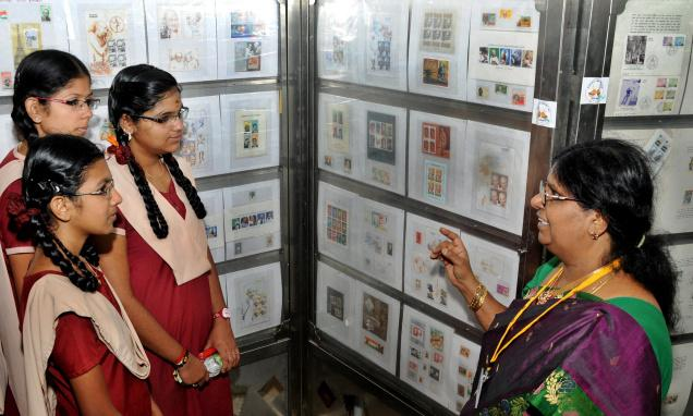 Students at 'Kovaipex 2014', a district-level philatelic exhibition at Techno Park, TNAU, in Coimbatore on Thursday. Photo: S. Siva Saravanan / The Hindu