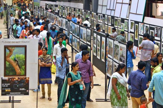 Visitors having a look at the exhibits displayed in 'Click Your Pic 2014' wildlife photography contest and expo at Brookefields Mall in Coimbatore. / by Special Arrangement / The Hindu