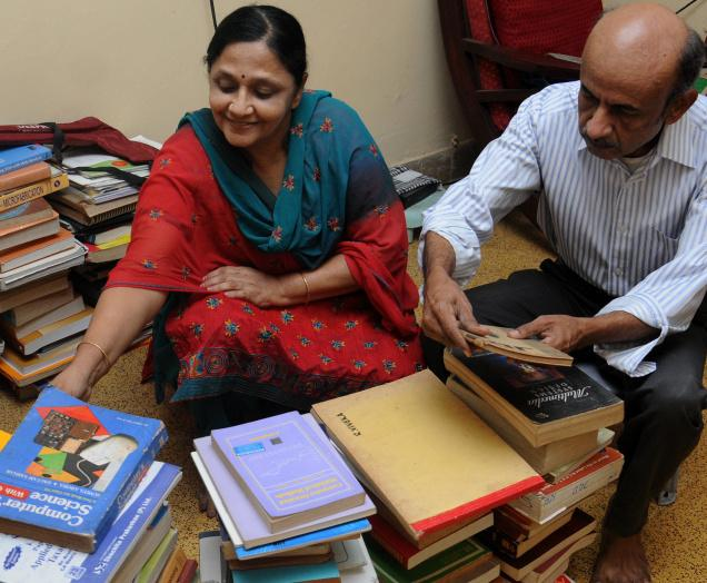 V. Chandrasekar, a key member of the Forum, is assisted by his wife Vijayalakshmi in sorting out the books meant for distribution. Photo: B. Jothi Ramalingam / The Hindu