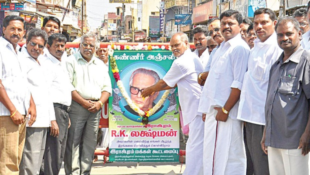 Activists of Rasipuram People's Forum and residents paying tributes to R K Laxman on Tuesday | express