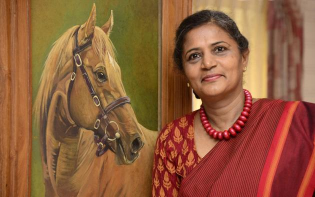 Sabrina Siga with her painting 'Equine Elegance.' Photo: R. Ravindran / The Hindu