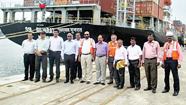 Officials standing near the vessel SSL Gujarat bound for Dubai at the VOC Port in Thoothukudi on Tuesday