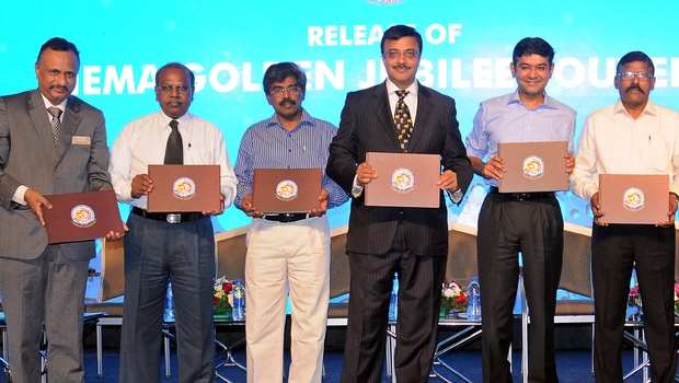 Vinod Dasari, MD, Ashok Leyland, (3rd from right), releasing a book 'Dawn of a Golden Era' during the aiema golden jubilee valedictory function, in chennai on saturday. (EPS)