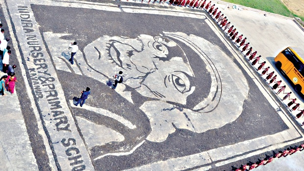 An aerial view of the portrait of Mother Teresa created by students of a private school at Kavanur, in Vellore on Saturday | express
