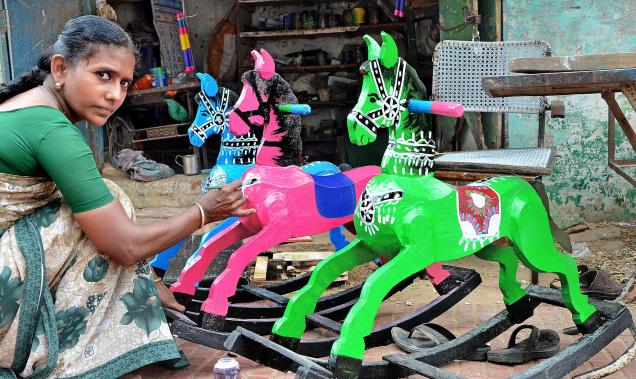 Pushpalatha puts the finishing touch on her rocking horses at her workshop in Thanjavur. Photo: B. VELANKANNI RAJ / The Hindu