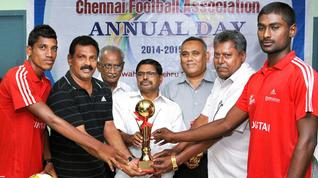 Chief guest Justice D. Hariparanthaman (centre) of Madras High Court hands over the senior division trophy to Hindustan Eagles.— PHOTO: M. MOORTHY