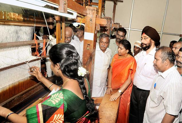 Minister for Handlooms and Textiles S. Gokula Indira inaugurating a weavers' training centre at Paramakudi on Thursdy. Minister for Sports and Youth Welfare S. Sundararaj and Principal Secretary, Handlooms and Textiles, Harmander Singh are seen.