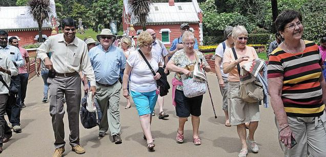 Tourists from England at the Government Botanical Garden in Udhagamandalam.— Photo: M.Sathyamoorthy