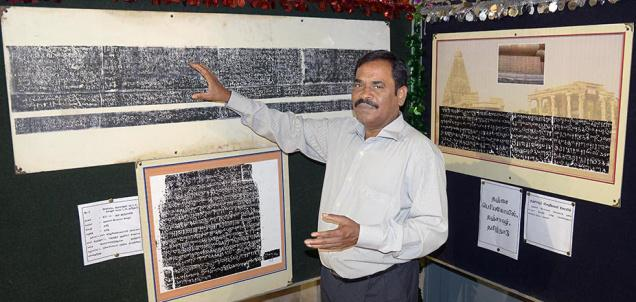 K. Karuppiah, Deputy Superintending Epigraphist, at the exhibition on Sunday —Photo: S.R. Raghunathan