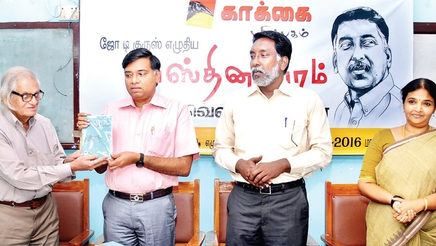 Historian K R A Narasiah giving the first copy of Joe D'Cruz's (third from left) novel to Agriculture Department Commissioner M Rajendran, as critic Chitra Balasubramanian looks on   d sampathkumar