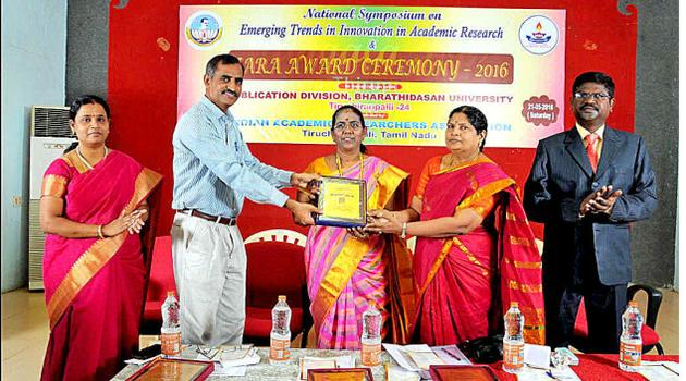 G. Valli, Vice-Chancellor, Mother Teresa Women's University, being conferred the Best Scientist Award at a symposium held in Bharathidasan University