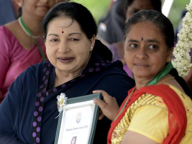 Chief Minister Jayalalithaa presents the Kalpana Chawla Award to Jayanthi during Independence Day celebrations in Chennai.