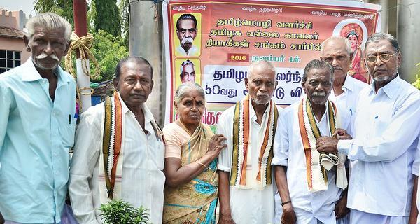 In recognition:Tyagis and leaders being honoured in Dindigul on Tuesday during celebrations to mark the 58th anniversary of Tamil Nadu Formation Day.— PHOTO: G. Karthikeyan