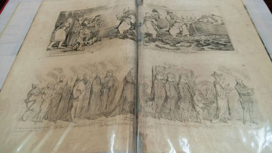 A collection of cartoon prints by legendary political satirist James Gillray is one of the restored books / PM Naveen