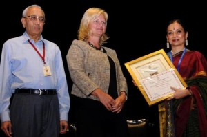 Susan Tuller, Deputy Consular General, Consulate General of United States, in Chennai, presenting the title to Bharatanatyam exponent Malavika Sarukkai at The Music Academy's 11th dance festival. Academy president N. Murali is in the picture.