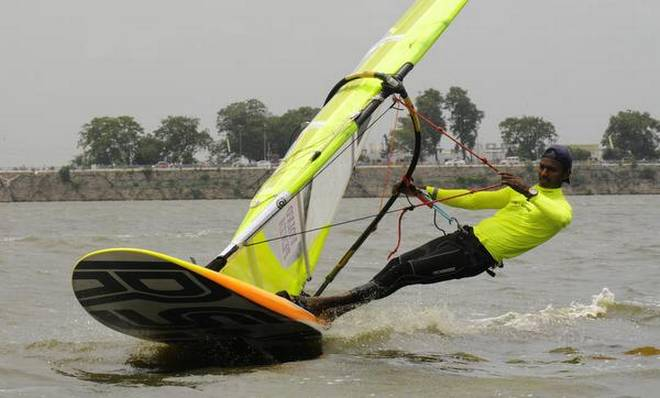 Waltzing to victory: Jerome Kumar Savarimuthu of the Army Yachting Node, Mumbai, who won all three races in the RS:X class on Tuesday. | Photo Credit: G. Ramakrishna