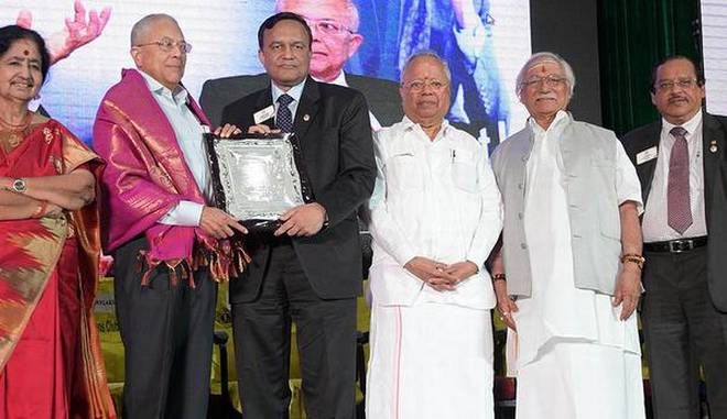 Special moment: Sanjay Khaitan, former international director, Lions Club, presenting the Lions Centennial Marquee Awards in Chennai on Sunday. | Photo Credit: K. Pichumani